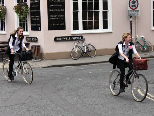 Oxford students on their way to their last exam in May. Oxford only have 24 weeks of teaching per year.